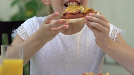 fattening : Young girl eating deep-fried fatty pizza, unhealthy nutrition, risk of gastritis Stock Footage