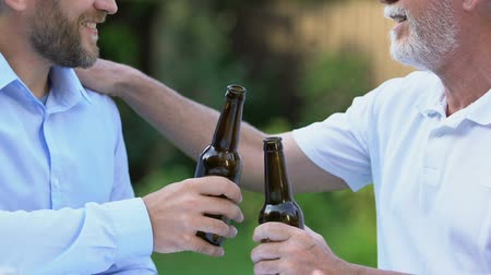 lasting : Two men drinking beer, long lasting brewing traditions, farther and son talking Stock Footage