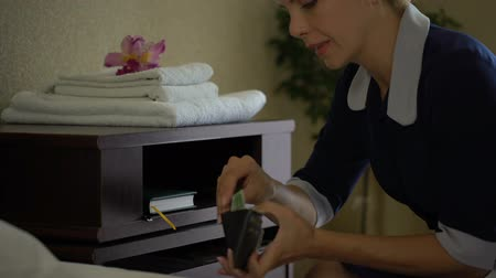 poorness : Greedy maid steals euros money from hotel residents purse after cleaning.