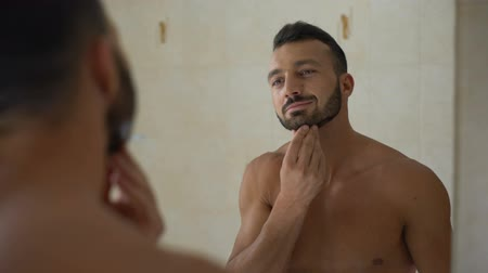 bigode : Sexy man proudly touch beard and moustache after visiting barbers shop, haircut