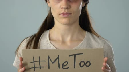 haklar : Me too hashtag poster in bruised woman hands, sexual assault victim asking help Stok Video