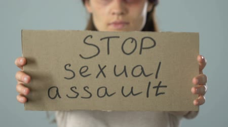 aggrieved : Stop sexual assault poster in bruised woman hands, problem awareness prevention