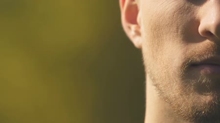 temper : Half face portrait of unhappy man trying to control negative emotions, closeup Stock Footage