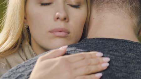luto : Sad woman embracing man, supporting friend in depression, sincere sympathy Stock Footage