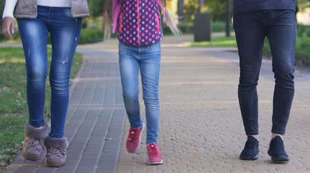 восхищенный : Happy girl walking with parents after school, boasting of interesting classes Стоковые видеозаписи
