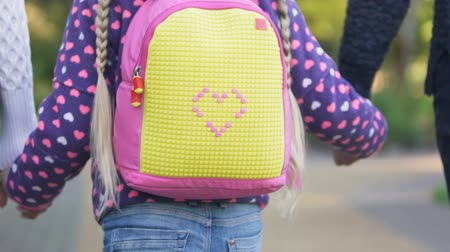 notas : Parents leading daughter to first grade, school time for children, education