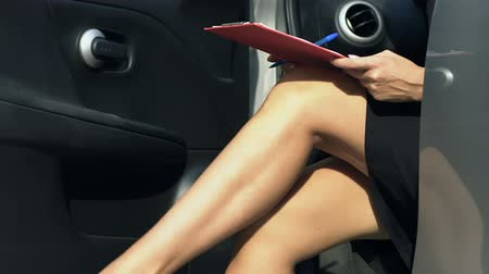 autolease : Business lady writing speech lonely sitting in car on parking lot busy lifestyle