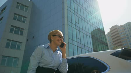 regozijo : Extremely happy lady rejoicing promotion or successful contract by smartphone Stock Footage