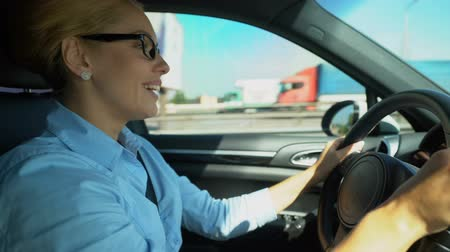 delighted : Cheerful woman driving and singing along, full of energy for challenging day