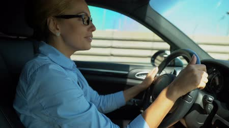 autoradio : Business lady driving and singing favorite tune, energy for challenging day