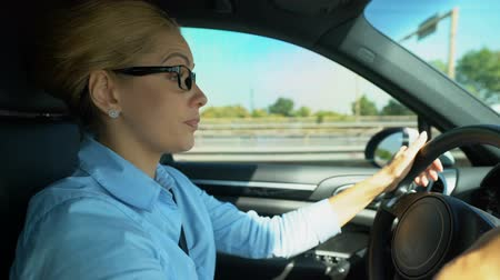 deprivation : Woman puts on glasses while driving, blurred vision and risk of car accident