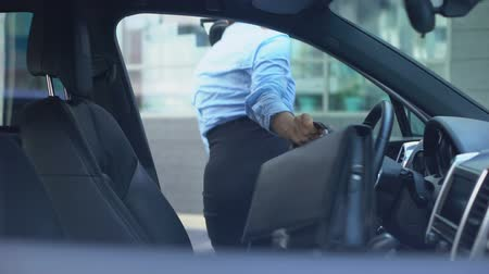 prawo jazdy : Respectable woman gets out of car parked near office center.