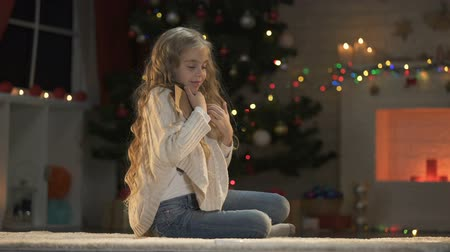 miraculous : Nice girl hugging envelope, dreaming about Christmas presents, belief in miracle
