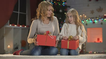 happy socks : Woman and girl warping Christmas presents, holiday eve preparations, wishlist Stock Footage