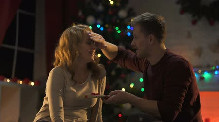 miraculous : Handsome male giving happy wife X-mas present wonderful holiday atmosphere, love