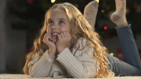 miraculous : Cute little girl dreaming about gifts and cheerful celebration of Christmas, joy