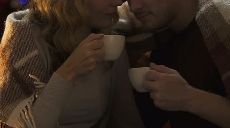 słoneczko : Happy lovers drinking coffee at New Year eve, warming and caressing each other Wideo
