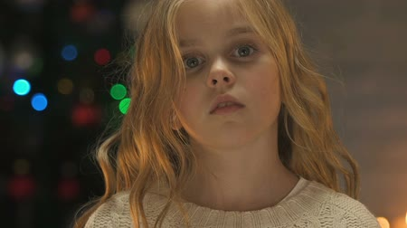 święta : Child holds out hand to camera, concept of help or orphan adoption at Christmas