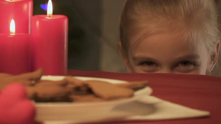 восхищенный : Little girl stealing gingerbread cookie, magic Christmas time in childhood