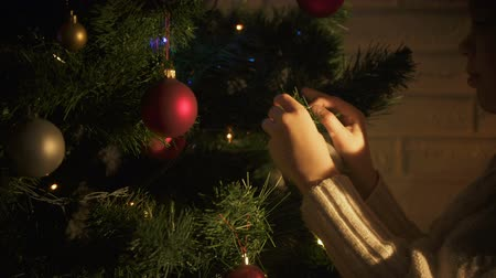 happy socks : Little girl hanging ball on Christmas tree, decorating before holiday, tradition