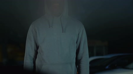 aim : Anonymous killer standing in front of car and pointing gun at driver, revenge Stock Footage