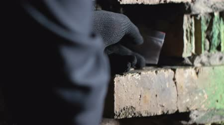 sentetik : Dealer hiding cocaine package in brick wall hole, smuggling, hands close-up
