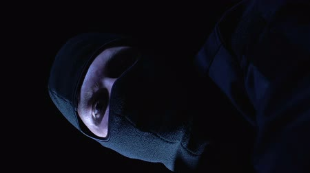 balaclava : Pov of victim, criminal in balaclava closing mouth and trying to strangle person