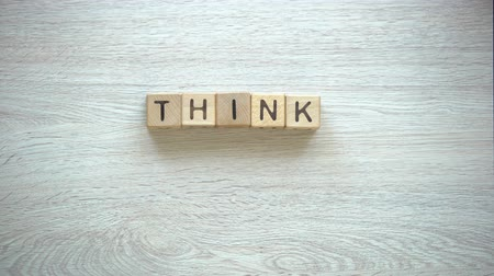 frase : Think positive, woman making phrase of cubes, motivation and inspiration, art