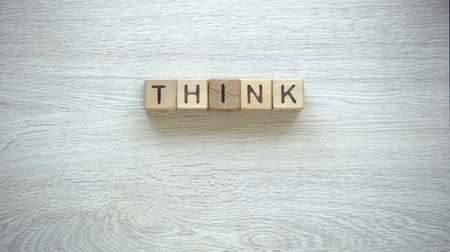 possibile : Think positive phrase made of cubes, psychological help to fight insecurities Filmati Stock