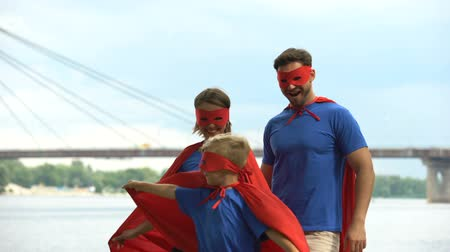 fearless : Parents in superhero costumes play with son, psychotherapy to cope with problems Stock Footage