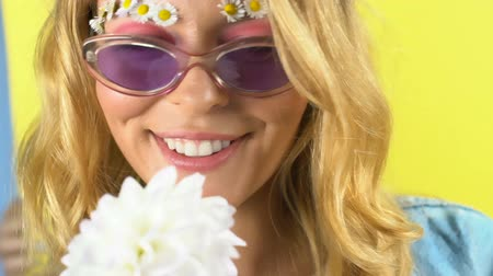 основа : Attractive woman with white flower smiling and posing into camera, cosmetics