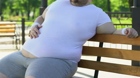 fardo : Overweight man feeling back ache after exhausting training, obesity consequences