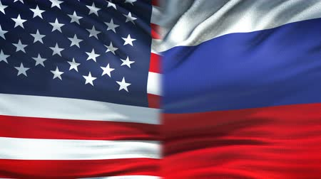 humanitarian : United States and Russia flags background, diplomatic and economic relations Stock Footage