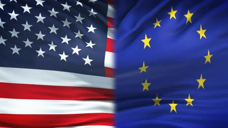 humanitarian : United States and European Union flags background, diplomacy, economic relations Stock Footage