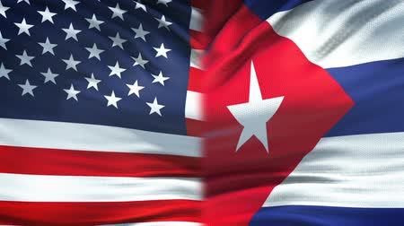 ministros : United States and Cuba flags background, diplomatic and economic relations