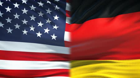 глобализация : United States and Germany flags background, diplomatic and economic relations Стоковые видеозаписи