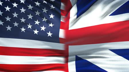 экономический : United States and Great Britain flags background, diplomacy, economic relations Стоковые видеозаписи