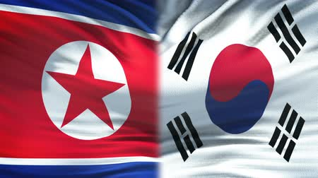 oposição : North Korea and South Korea flags background, diplomatic and economic relations