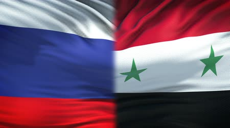 damasco : Russia and Syria flags background, diplomatic and economic relations, business