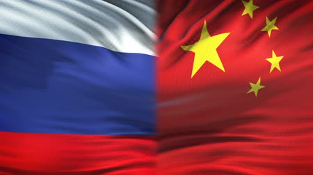 peking : Russia and China flags background, diplomatic and economic relations, business Stock mozgókép