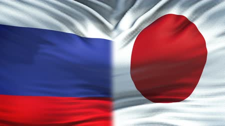 tokyo government : Russia and Japan flags background, diplomatic and economic relations, business Stock Footage