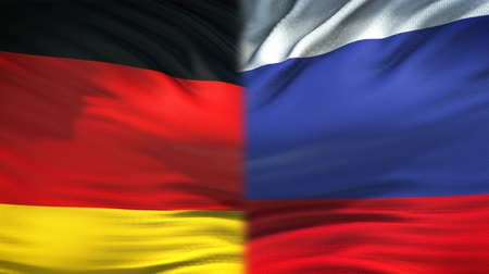 humanitarian : Germany and Russia flags background, diplomatic and economic relations, business Stock Footage