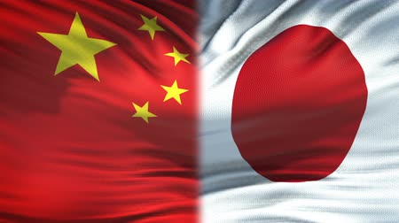 peking : China and Japan flags background, diplomatic and economic relations, business Stock mozgókép