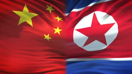 peking : China and North Korea flags background, diplomatic and economic relations