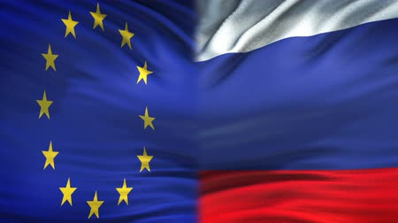 humanitarian : European Union and Russia flags background, diplomatic and economic relations Stock Footage