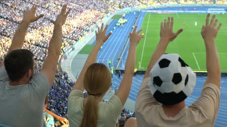 world cup : Football fans shaking fingers, cheering for national team in stadium, slow-mo