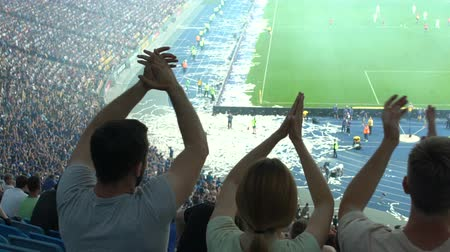 penas : Group of fans clapping hands, supporting football team at stadium, slow-mo Stock Footage