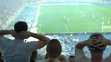 penas : Football fans frustrated with losing game, showing desperate emotions, slow-mo Stock Footage