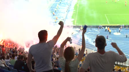 si : Football fans show gesture yes for goal, adrenaline and emotions when team win
