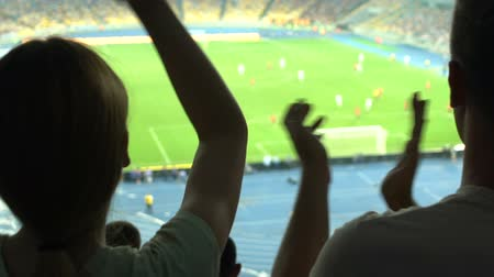pozitivity : Couple rejoicining football match victory, positive and adrenaline during game